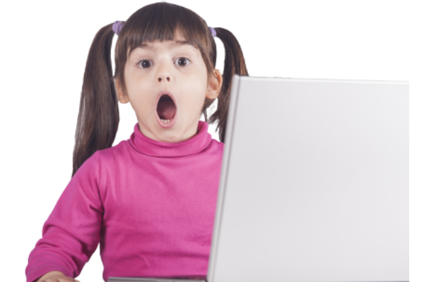 Surprised little girl at a computer